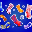 Collection of socks with snowflake over blue background — Imagen vectorial