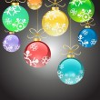 Christmas color balls with ribbons hanging — Imagen vectorial