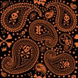 Pattern with a paisley and skulls - Stock Vector