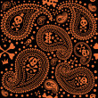 Pattern with a paisley and skulls — Stock Vector