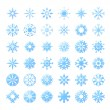 Thirty six blue snowflakes — Stock Vector
