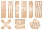 Set of beige plasters — Stock Vector