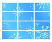 Doce tarjetas azules con copos de nieve — Vector de stock