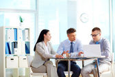 Round table for three — Stock Photo
