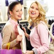 Cheerful shoppers - Stock Photo