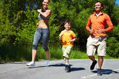 Family jogging in the open air enjoying summer vacations — Stock Photo