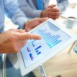 Business, graphs and charts on touchpad — Stock Photo #12510695