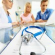 Stock Photo: Stethoscope and document