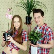 Couple with plants - Stock Photo