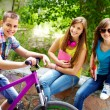 Girls and biker — Stock Photo