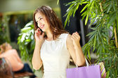 Phoning from mall — Stock Photo
