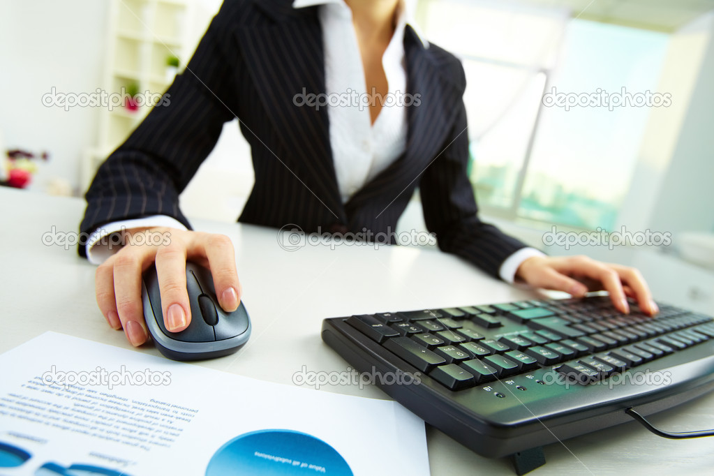 Image of female hands pushing keys of a computer mouse and keyboard with papers near by — Stock Photo #12510144
