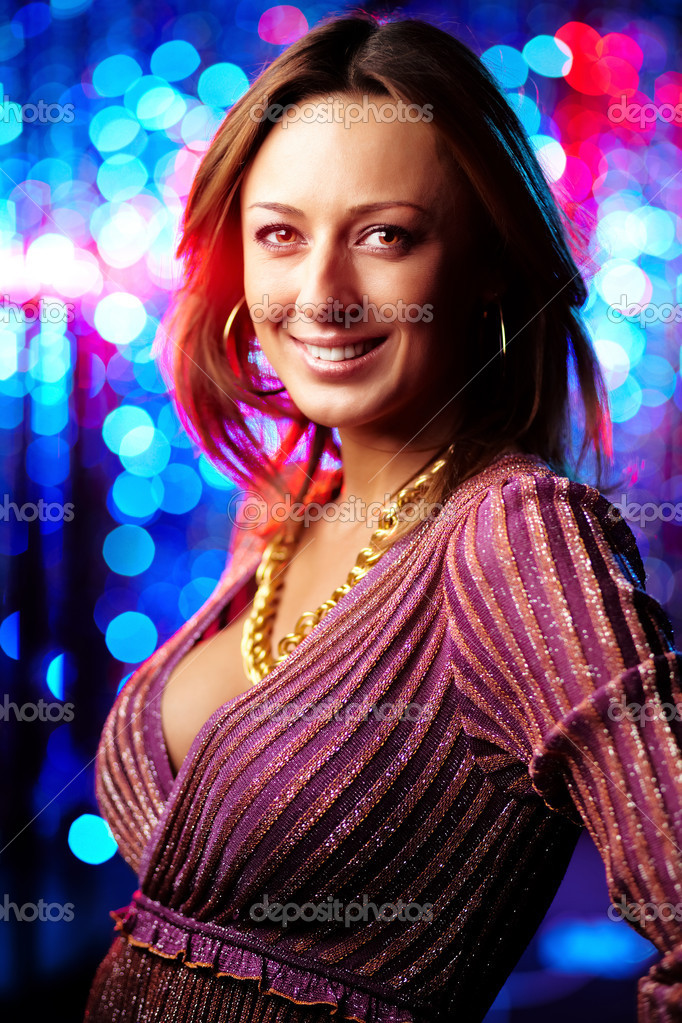 Vertical image of a beautiful lady against sparkling background  Stock Photo #12510152
