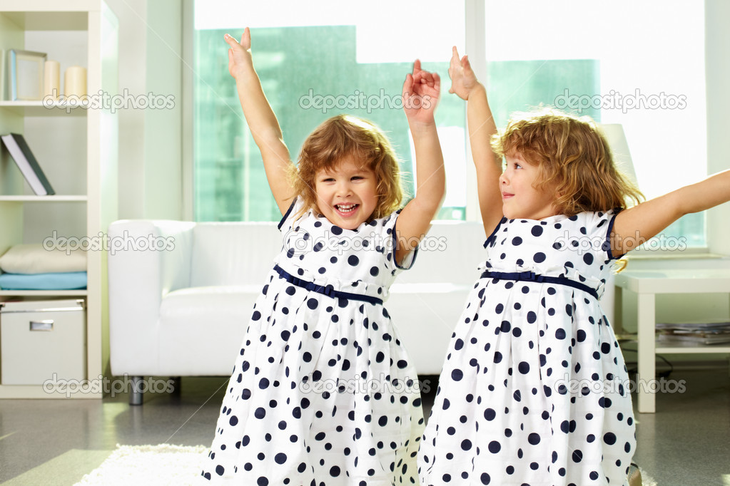 Adorable twin girls having fun together — Stock Photo #12516892