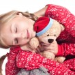 Sleepy girl with teddy bear — Stock Photo