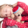 Stock Photo: Sleepy girl with teddy bear