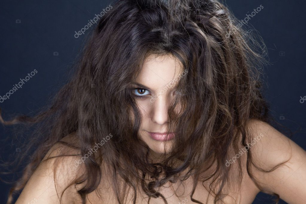 A portrait of a beautiful girl with disheveled hair — Stock Photo #10879787