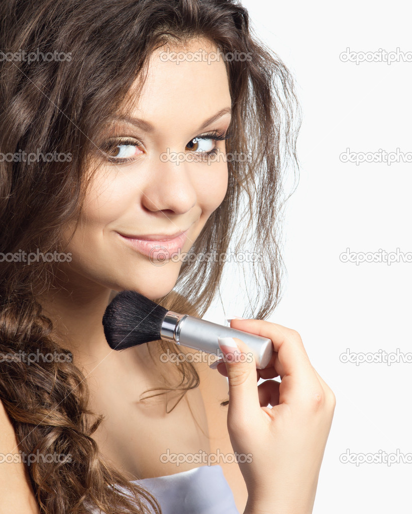 Beautiful young woman doing makeup isolated on white — Foto de Stock   #10879830