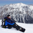 Stock Photo: Snowboarder relaxing