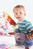 Happy kid is drawing picture — Stock Photo