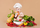 Child and vegetables — Stock Photo