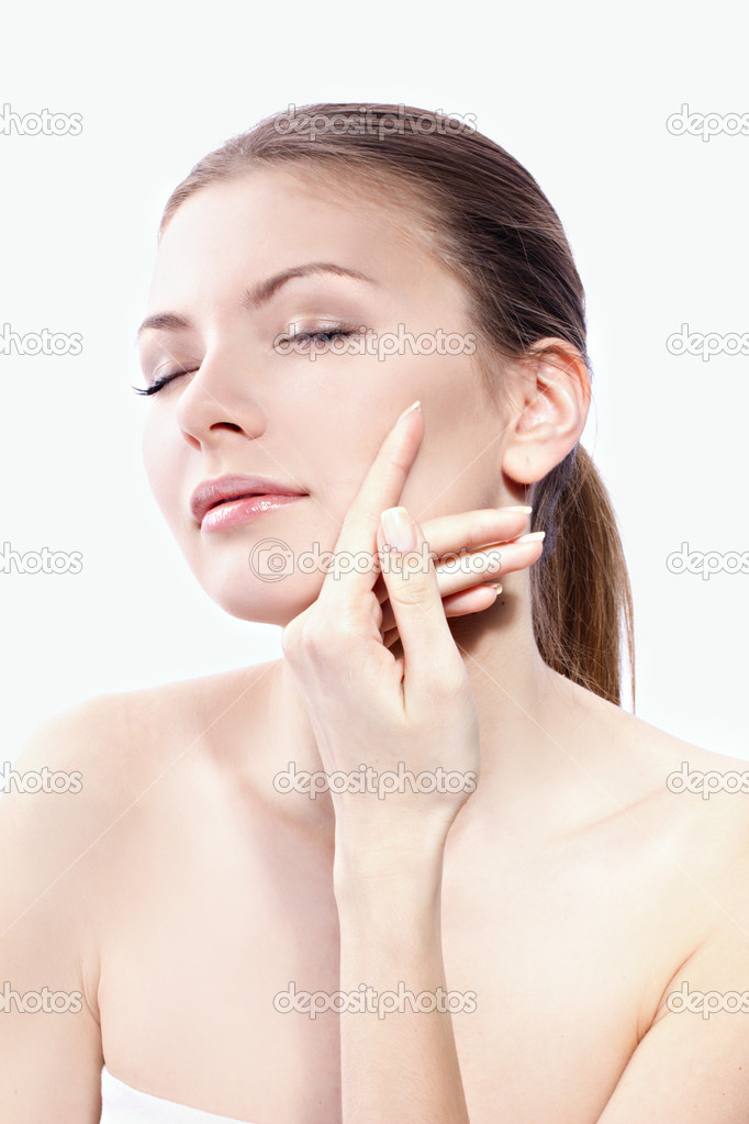 Closeup portrait of a pretty woman with closed eyes isolated on white backgroung — Stock Photo #10882443