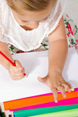Beautiful little girl drawing with pencil — Stock Photo