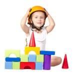 Little girl playing wiht blocks — Stock Photo