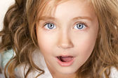 Portarit of an amazed little girl — Stock Photo