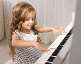 Little piano player — Stock Photo