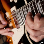 Playing guitar — Stock Photo #12154833