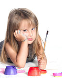 Sad girl and paints — Stock Photo