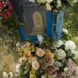 Stock Photo: Old fake flower on grave