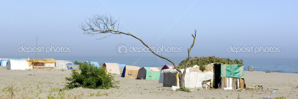 Poor camp on the beach — Stock Photo #10867388