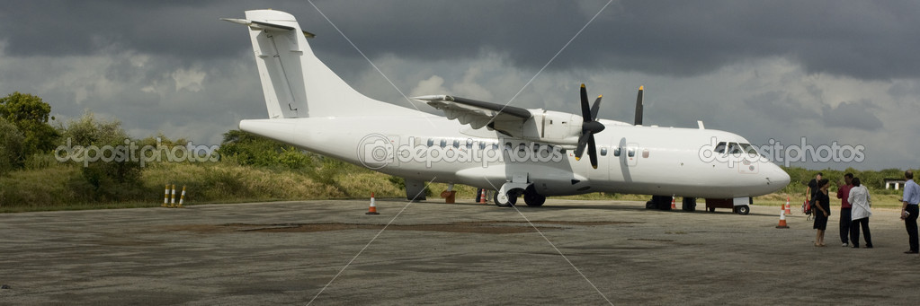 Airplane under cloudy sky in Kenya — Stock Photo #10870046