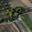 Aerial view of empty road and fields - Stock Photo
