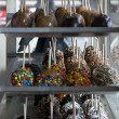 Close-up of chocolate and caramel covered apples - Stock Photo