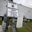 Warning sign in yard after Hurricane Katrina, New Orleans, Louisiana - Stock Photo