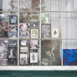 Vintage photographs in window in New Orleans, Louisiana - Stock Photo