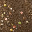 Discarded soda caps in ground, Tanzania, Africa - Foto Stock