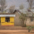 Yellow wooden gift shop, Tanzania, Africa - Stock Photo