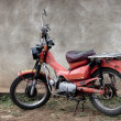 Stationary red motorcycle, Tanzania, Africa — Stock Photo #10885086