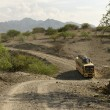 Bus traveling on dirt road, Tanzania, Africa — Stock fotografie