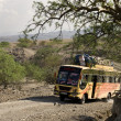 Bus traveling on dirt road, Tanzania, Africa — Stock Photo