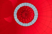 Low angle view of inside a red hot air balloon — Stock Photo