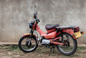 Stationary red motorcycle, Tanzania, Africa — Stock Photo