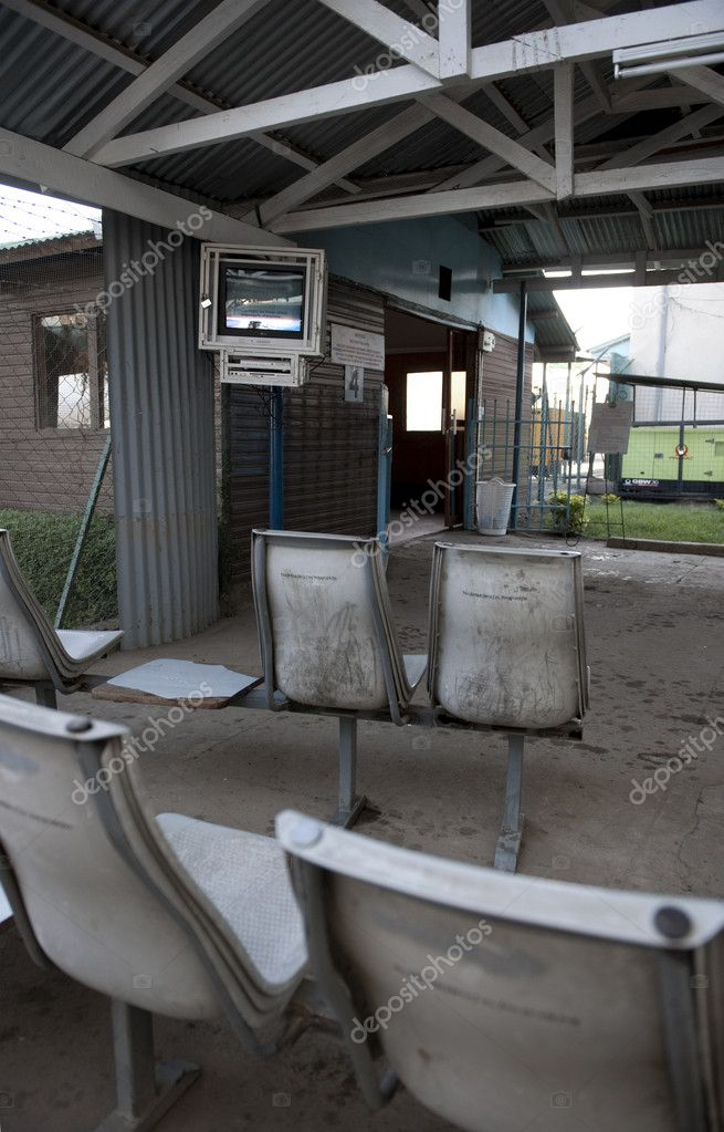 Dirty outdoor seating with television on — Stock Photo #10884537