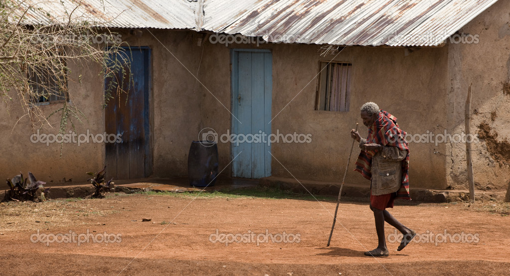 Senior woman walking through village, Tanzania, Africa — Stock Photo #10885072