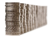 Stacks of 2 Euros Coins in front of white background — Stock Photo