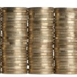Stacks of 1 Euros Coins in front of white background — Stock Photo